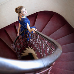 Classic portrait of elegant woman on staircase