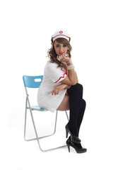 Sexy nurse sitting isolated
