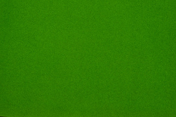 Texture of dense cardboard with green velvety  coating