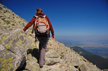 woman tourist on mountain