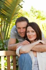 Joyful couple hugging in the garden
