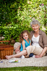 Grandmother with her granddaughter in the garden