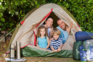 Joyful family camping in the garden