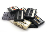 Old audio tape cassettes on white background