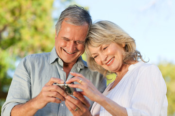 Mature couple looking at their camera