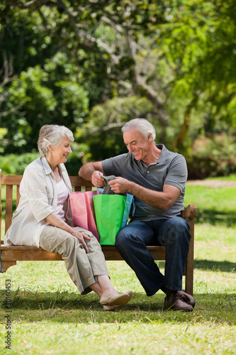 Retired couple with shopping bags