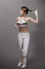 Young teenager girl with rugby ball