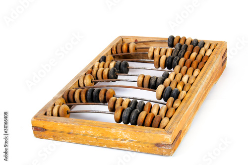 Old wooden abacus with a calculated sum