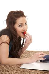Woman eat stawberry homework biting