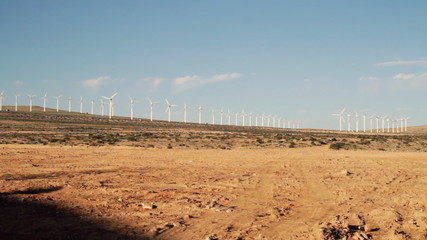 An electric wind farm / windmills in the desert