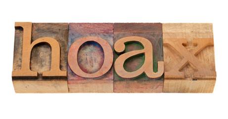 hoax - word in letterpress type