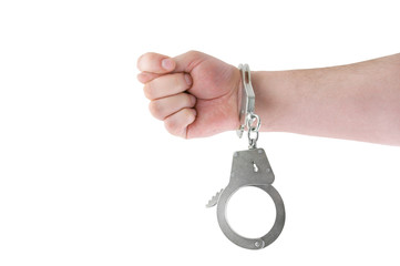 Steel metallic handcuffs on hand isolated