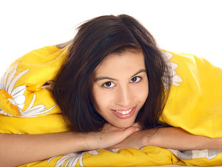 smiling teenage girl lying comfortably in bed