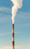 Smokestack with smoke over blue sky poster