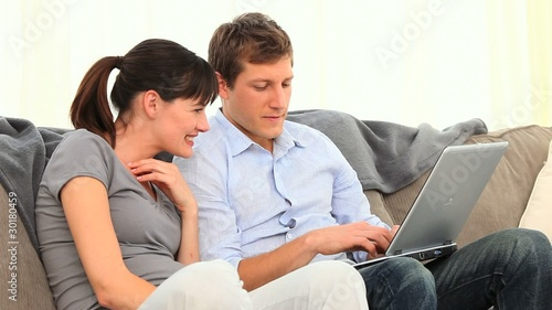 Cute couple using a laptop