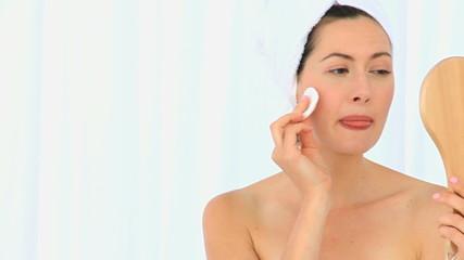 Brunette putting on make-up