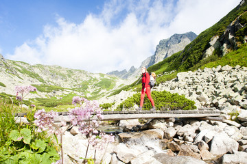 woman backpacker in Great Cold Valley, High Tatras, Slovakia