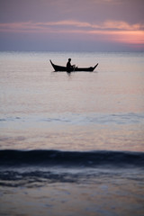 Smal thai fisherboat silhouetted