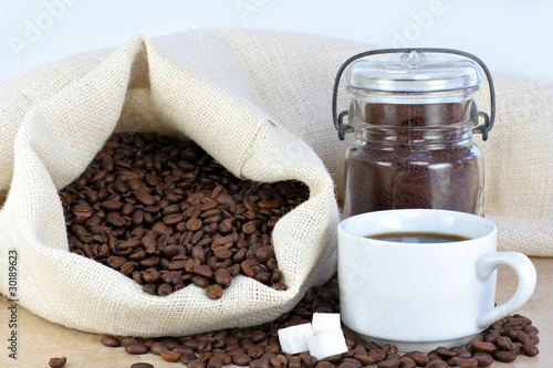 Hot coffee, beans and sugar cubes.