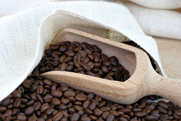Coffee beans, a sack and a scoop.