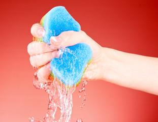 Squeezing sponge on background