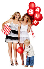 two girls and a little boy with sale sign on balloons.