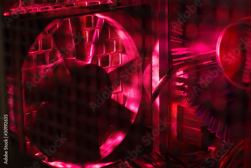 Inside of a desktop computer in the red light