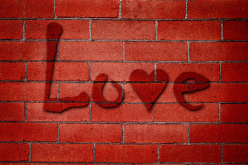 Love Graffiti on Red Brick Wall