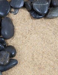 zen spa river rocks and shells on sand in form of border