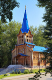 Wooden lutheran church in Tomsk, Russia poster