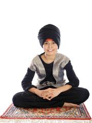 smiling boy sitting on a magic carpet