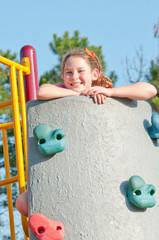 girl playing on climbing wall