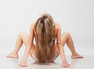 fit blond in white underwear practicing yoga