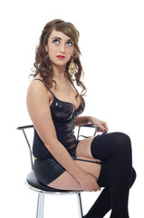 Pretty sexy young woman sat on stool isolated