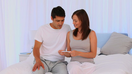 Couple looking at a positive pregnancy test