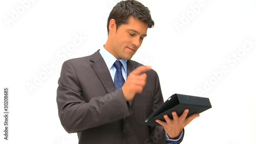 Businessman working on his tablet against a white background