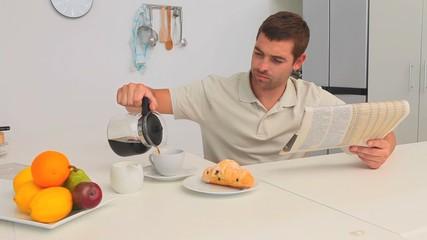 Man having breakfast in the kitchen
