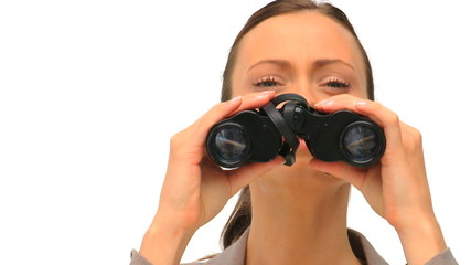 Lovely woman looking through binoculars
