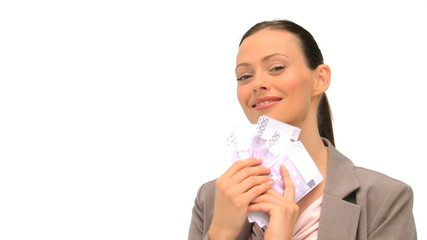 Businesswoman counting her money against a white background