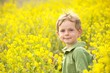 Young Boy in a Field of Yellow Flowers