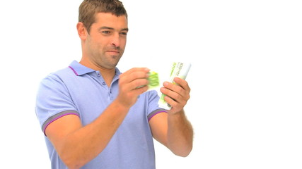Happy man counting his money against a white background