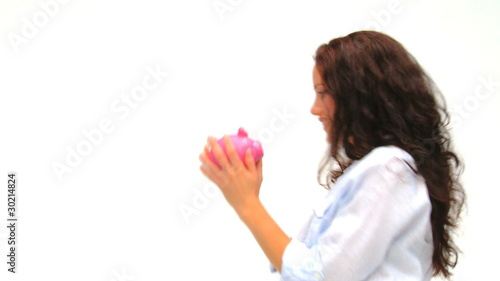 Woman with her piggy bank against a white background