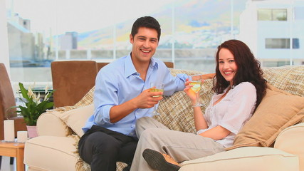 Couple drinking wine in their living room