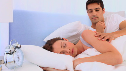 Man waking up her girlfriend