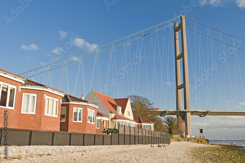 Housing next to a large suspension bridge