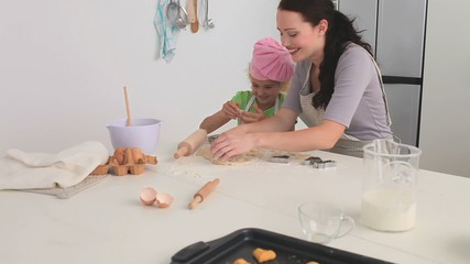 Mother and her daughter cooking together