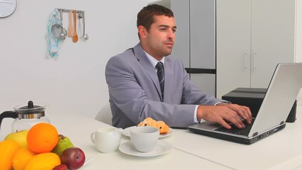 Businessman working during his breakfast