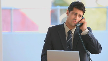 Businessman dressing in a business suit speaking on the phone