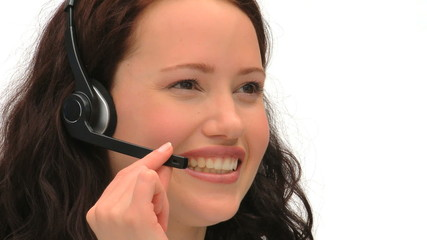 Brunette woman speaking over the headset