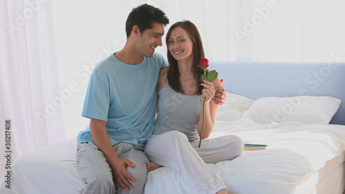 Lovely couple holding a rose